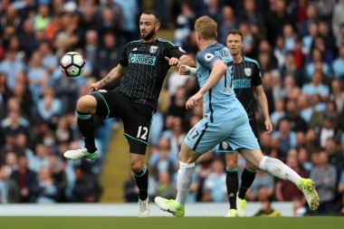 Kevin De Bruyne of Manchester City competes with Marc Wilson of West Bromwich Albion